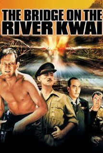 """""""The Bridge on the River Kwai"""" (1957). After settling his differences with a Japanese PoW camp commander, a British colonel co-operates to oversee his men's construction of a railway bridge.  This is a fantastic classic, with Alec Guinness and William Holden.  It really is a """"must-see."""""""