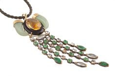 Inspired from the elements of nature, this pendant is set in 18k gold and silver along with green aventurine, citrine, black onyx, emerald,moonstone and aquamarine. www.studiotara.com