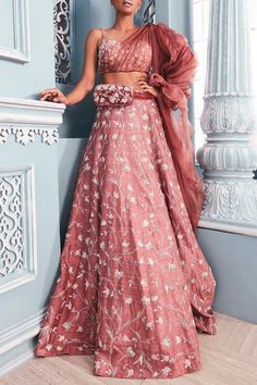 Coral Embellished Corset Blouse With Lehenga Skirt Design by Mahima Mahajan at Pernia's Pop Up Shop Indian Gowns Dresses, Indian Fashion Dresses, Indian Designer Outfits, Indian Outfits, Indian Wedding Gowns, Ethnic Outfits, Indian Attire, Indian Clothes, Unique Outfits