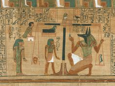 The heart of the deceased is weighed by Anubis, the jackal-headed god of death. One of the challenges that a person's spirit faced on the journey to the afterlife in ancient Egypt.