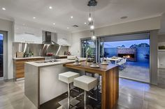 Smart kitchen with an extended addition to the kitchen island that serves as a dining table