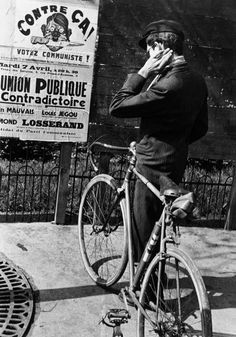 Robert Capa Paris. Campaign for the legislative elections. The Popular Front, a coalition between socialists, communists and other antifascist parties which governed France between 1936 and 1938, won the election. Spring 1936.