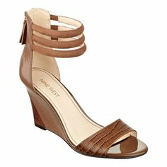 A snake-embossed strap brings an exotic flair to our Floriscine open-toe wedge sandals topped with a trio of ankle straps. Back zip for easy on/off. Padded footbed for all-day comfort. Leather upper. Man-made lining and sole. Imported. 3 inch wedge heels. Women's shoes. Sandals.