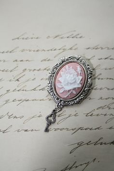 Pink Rose cameo brooch.