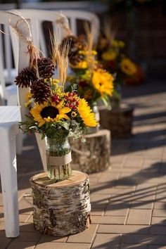 Sunflower bouquets in glasses and on birch trunks Rustic country sunflowers wedd. Sunflower bouquets in glasses and on birch trunks Rustic country sunflowers wedding centerpiece ideas Sunflower Wedding Centerpieces, Sunflower Bouquets, Outdoor Wedding Decorations, Wedding Table Centerpieces, Wedding Themes, Wedding Favors, Centerpiece Ideas, Wedding Ideas, Fall Sunflower Weddings