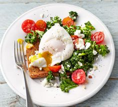There's no tastier way to eat kale than smothered in a runny yolk and scattered with feta cheese. This veggie, low-calorie breakfast has it all!
