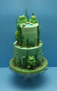 vanilla cake filled and frosted with vanilla buttercream. All other decorations, including the frogs, are made from modeling chocolate.