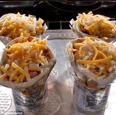 Forget calzone! Amateur cook uses drinks cans to make handy homemade pizza... in a cone