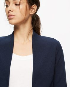 This easy-to-wear jacket is made from soft cotton with a contrast trim for a truly luxe feel. A neat fit through the body for a sleek silhouette, design features include a shawl collar, no fastening for a draped effect and an external centreback seam. Make this simple piece your perennial go-to this season.