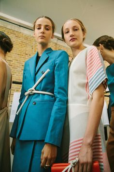 Bold, blue, tailored, suit dress and striped sleeves. Paul Smith looks to the vibrancy of David Hockney. Fashion's English eccentric draws upon the colour blocking of the painter's work Paul Smith SS16