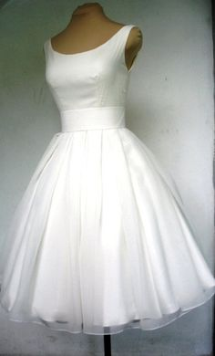 A beautiful ivory 50s wedding dress with boat neck, and darling tea length pleated skirt