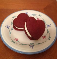 Red Velvet whoopies pies with cream cheese & marshmallow fluff filling    Use one box of red velvet cake mix, add three eggs, 1/2 cup water and 1/2 cup oil.  Mix well.  Pipe heart shapes onto parchment paper (you can trace the heart shape on the parchment using a cookie cutter and then flip it over if you need a guide).  Bake at 400 for 5-7 minutes.  Fill with a mixture of 1/4 cup butter, 8 oz cream cheese, 1 jar fluff (7 oz) and 2 cups powdered sugar.  Enjoy!