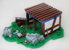 Here are some nice LEGO versions of essential medieval buildings from Age of Empires II by a group of LEGO enthusiasts. An Archery Range by Mark of Falworth and Barracks by Andrew JN above, and a few more below. Age Of Empires, Chateau Lego, Lego Age, Medieval Houses, Lego Castle, Lego Models, Lego Projects, Lego Building, Lego Brick