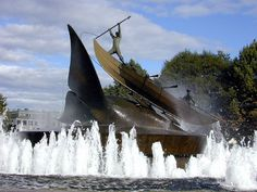 A fountain, in Sandefjord, Norway, of a whale tail and whale boat showing the harpooner with the typical early harpoon attached to a rope.