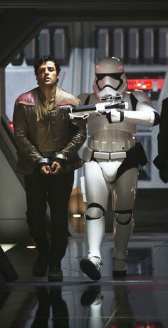 Oscar Isaac as Poe Dameron with a Stormtrooper in Star Wars: The Force Awakens (2015)