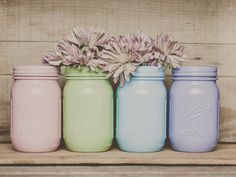 Paint a collection of Mason jars in cheerful pastel shades to use as centerpiece vases.