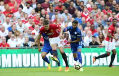 Riyad Mahrez of Leicester City in action with Michael Carrick of Manchester United during the FA Community Shield Match between Leicester…