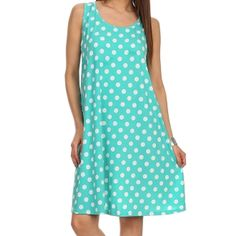 Cute and colorful, this trendy shift dress showcases a cheerful polka dot print. Finished with a darling keyhole detail at the back, this dress has a relaxed fit making it comfortable and easy to wear.