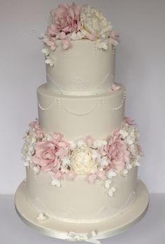Ivory & blush three tier wedding cake with roses, hydrangea & peonies