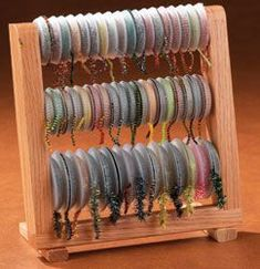 "oasis Oasis Chenille Center OASIS CHENILLE CENTER is an ingenious, compact storage rack that ""soaks up"" and organizes all kinds of yarns and chenilles. The rack comes with 50 EMPTY SPOOLS in two sizes Fly Tying Desk, Fly Tying Tools, Fly Tying Materials, Fly Fishing Gear, Fishing Lures, Fishing Rods, Fishing Tackle, Ice Fishing, Trout Fishing"