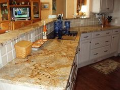 Lapidus Granite....wasn't sure about all the copper in this granite, but it might look great with my dark cabinets and copper sink?