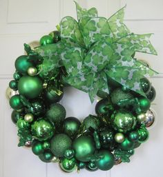 St. Patrick's Day wreath! Easy to do, and cheap! Just buy the green ornaments after Christmas to get them discounted.
