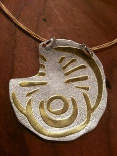 Rock Basin Pendant.Silver and 24k gold.Inspired by Irish symbols.  Http://www.deirdredonnelly.com