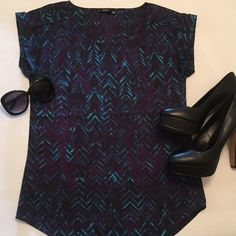 GORGEOUS SILK TOP This top has a beautiful pattern in rich colors. You can easily style this piece for work, casual, or a night out. Made from polyester it is durable enough to hold a long term place in your closet. Fits more accurately like a small. Express Tops Blouses