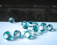 Turquoise and silver foil glass beads by allthatglittersbeads, $3.00