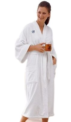 """White Terry Velour Bath Robe Size: One Size Fits Most Adults You will love slipping into the luxurious feel of this 100% cotton, soft terry velour bath robe. Our plush robe is super absorbent and has double belt loops and side patch pockets. It fits most sizes and is a full 48"""" mid-calf length. It is the perfect thing to cover up after a hot shower or a cool dip in the pool. This thick Terry Velour Bath Robe makes a great gift for the newlyweds. Surprise them by giving them a matching…"""