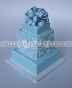 Cornflower Cake | www.onceuponacake.com.au Simple but very neat and the texture provided by the bas relief type flowers on the middle tier really sets off the blue and white theme.