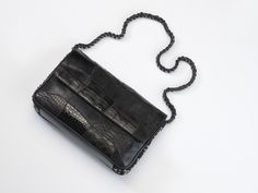 No#R1545 Patchwork of black crocodile,  semi-shiny black lizard and python. Shiny black python on the back. Indigo Provencal ¨pique¨ with rounded silver studs on the sides. 19th-century Venetian black velvet on the inside. Pale pink leather inside lining.
