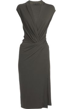 the wrap effect. Wool jersey sheath dress  by Donna Karan
