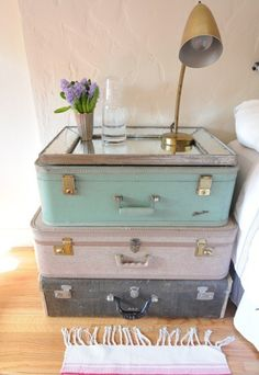 Suitcases and framed mirror into side table