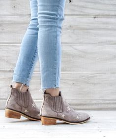 Our favorite newgrey bootie is here! Be edgy and chic in our new western inspired Star Gazer Bootie! The perfect wooden stacked heel and Coachella ready style!