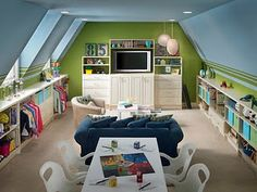 Great playroom!  Not so sure I'd include a TV, but love all of the shelves & the little table.
