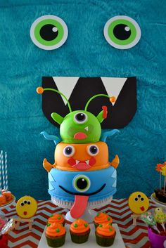 Amazing cake and cupcakes at a monsters birthday party! See more party planning ideas at CatchMyParty.com!