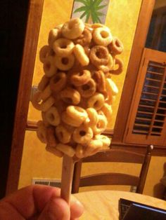 A banana covered in peanut butter and rolled in cheerios=healthy breakfast on a stick:) my SINBAD will love this!