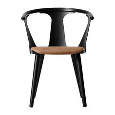 &+Tradition+In+Between+Chair+SK2+-+Black+Stained+Ash+with+Cognac+Silk+Aniline+Leather+Seat+-+Stained+ash+and+formpressed+veneer+armchair+with+cognac+leather+seat. A+visual+representation+of+the+correlation+between+positive+and+negative+space,+this+distinctive+stained+ash+wood+chair+from+&+Tradition+is+a+modern+complement+for+both+classic+and+contemporary+interior+spaces. Created+by+Samio+Kallio+using+two+classic+techniques:+compression+veneer+moulding,+making+the+design+sleek+yet+s...