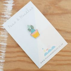 An enamel pin badge with an illustration of a cactus. 13mm x 22m, nickel enamel. All illustrations by Lucy Davidson