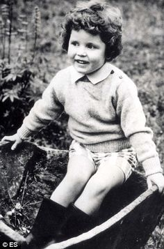 A young Sarah Ferguson (duchess of york) plays happily in the garden - but her smile belies an unhappy childhood