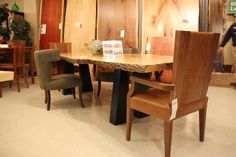A ravishing solid wood table with a live edge that will add charm and character to any dining room!   Houston TX   Gallery Furniture  