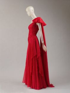 One of Nan Kempner's Valentino dresses, S/S 1987. Valentino red silk chiffon with white dots; now part of the collection of the Costume Institute of the Metropolitan Museum of Art.