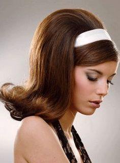 1960s big teased flip hairdo.