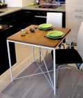 """Table """"KIRUNA"""" – as all our other furniture – is 100% handcrafted. The counter is made of solid ash wood protected by 3 layers of manually applied water-based stain preserver.  Both – color of construction and counter – can be customized to your preferences."""