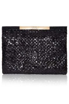 Angel Jackson | WOVEN SNAKESKIN POUCH IN BLACK £238.00 Genuine snakeskin is hand-woven to form a checkerboard graphic with our new Woven pouch. In sleek black, this pouch makes a great alternative to a structured clutch and is the perfect finishing touch to a chic outfit. Genuine woven snakeskin  Gold tone set down zipper Interior patch pocket for credit cards Dimensions:  22.5cm(H) X 30.5cm (W)