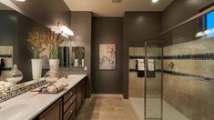 #oversize #walkin #shower by Taylor Morrison at Las Brisas.  I would use the big grey tiles instead of the brown