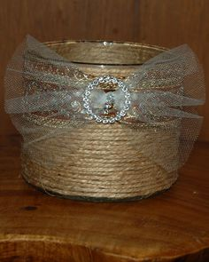 clear candle holder wrapped with jute/twine, ribbon and bling slider (for scrapbooking) with tulle slide through for bow.  Gift for a dear friend.  Really happy with how it turned out.