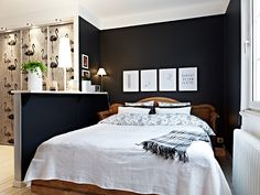 The dark walls against the clean white bedding and artwork!