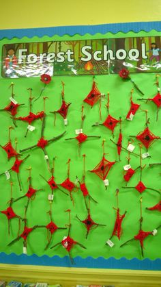 Remembrance Day Poppies created during our Forest School session. Find two similar sized twigs and secure into a '+' shape using black wool weaving in and out of the twigs to complete the poppy centre. Join the red wool onto the black wool and continue weaving to create the poppy.